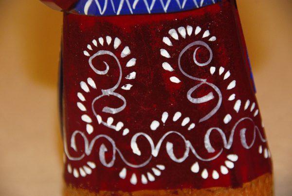 White swirl details on red coat