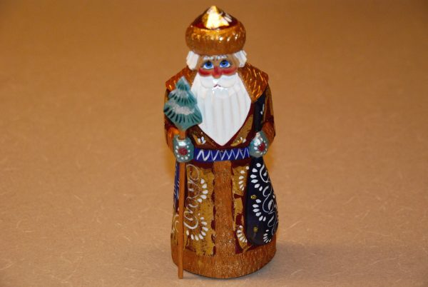 Wooded St. Nicholas figurine with gold coat and blue belt