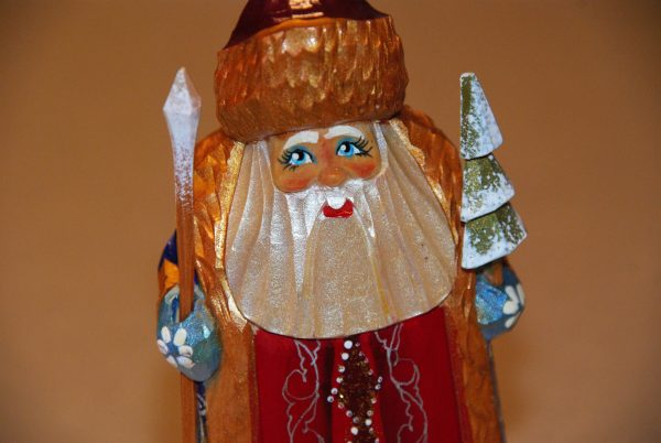 St. Nicholas figurine face details with staff and tree