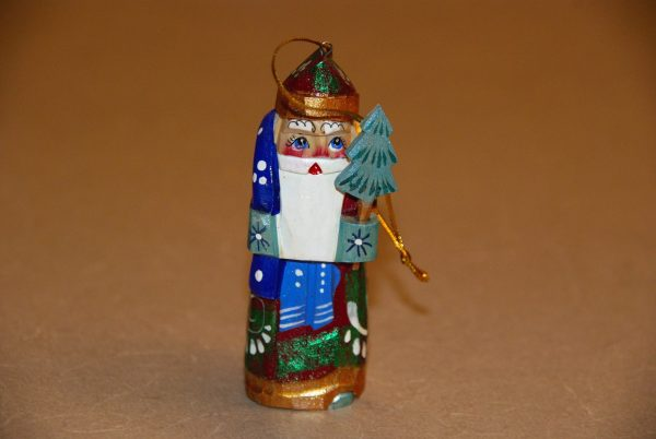 Front view of a St. Nicholas Christmas Figurine holding tree