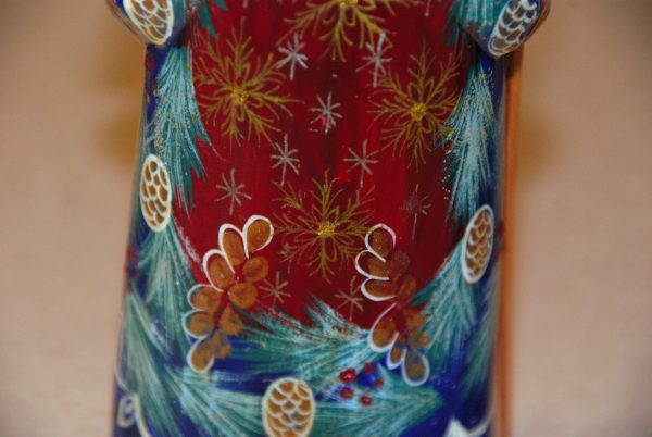 Detailed painted gold snowflakes on St. Nicholas Figurine