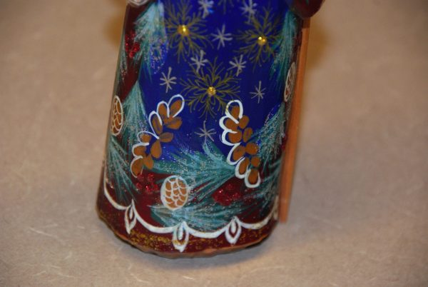 Painted details on the back of a St. Nicholas Christmas Figurine