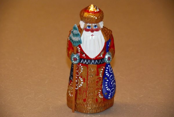 Front view of a gold painted St. Nicholas Christmas Figurine