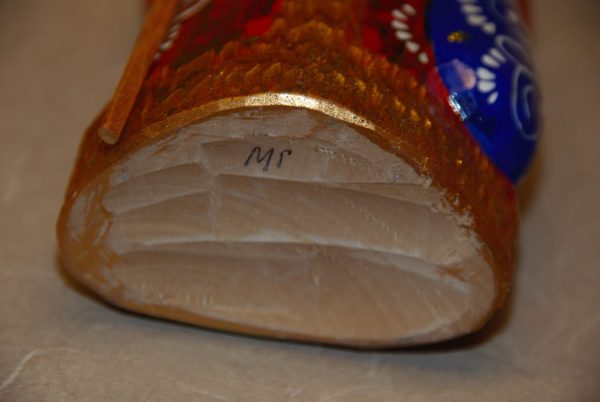 Initials on the bottom of a St. Nicholas Christmas Figurine