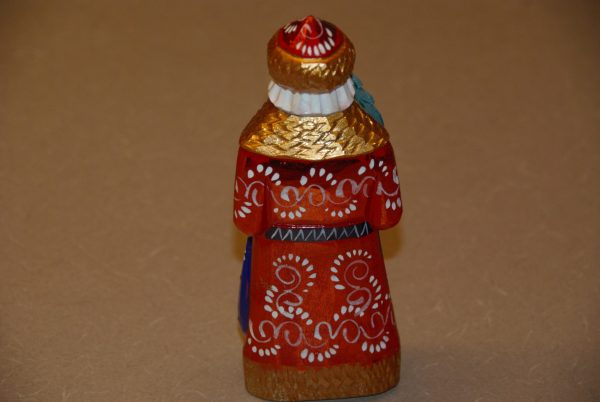 Red and gold St. Nicholas Christmas Figurine with white paint details