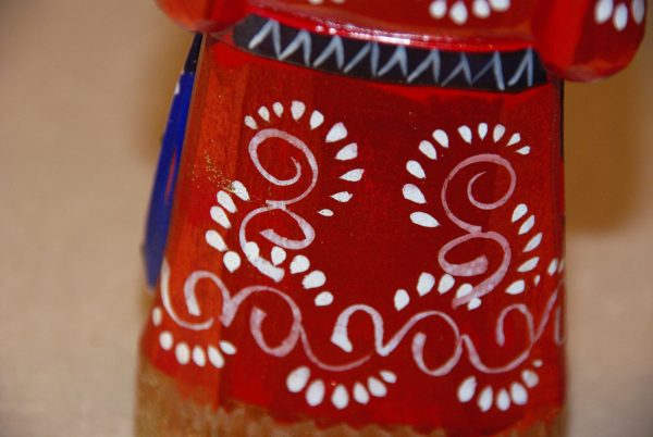 Paint details on a St. Nicholas Christmas Figurine