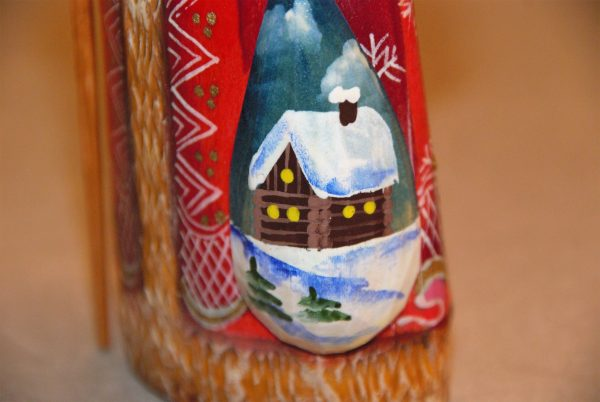 Snow covered log cabin painted on wooded St. Nicholas Christmas Figurine