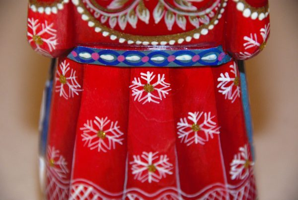 Red coat and white snowflakes with gold dot